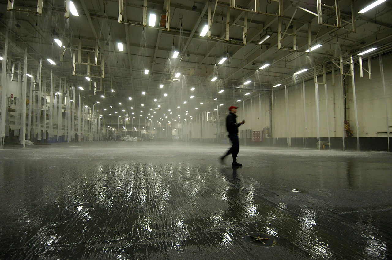 Damage Controlman 3rd Class Pat Knodel, of Orange County, Calif., monitors the testing of the hangar bay sprinkler system aboard the conventionally powered aircraft carrier USS Kitty Hawk (CV 63) during sea trials in the western Pacific Ocean